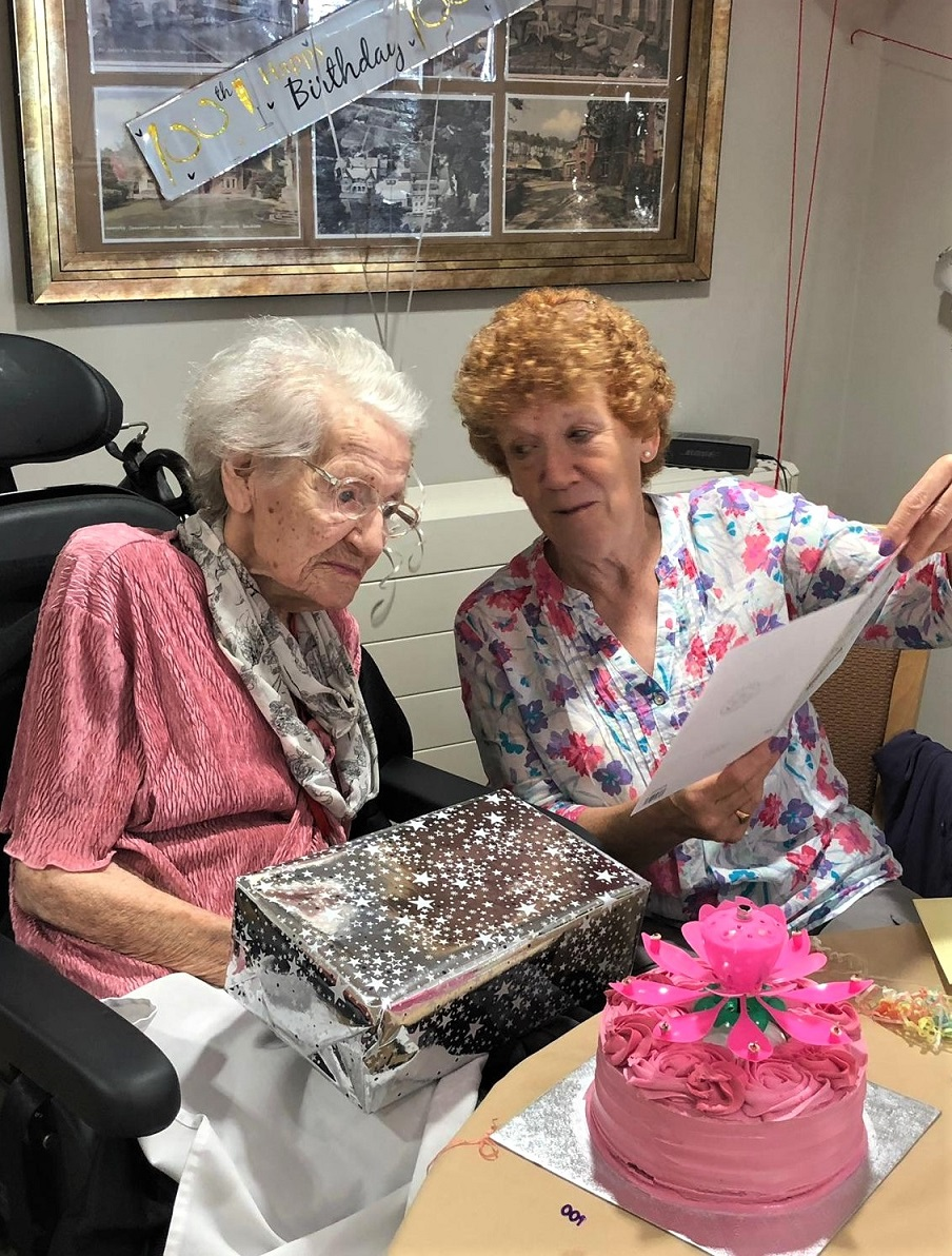 Meyrick Rise Care Home, Dorset-Addalane with a family member opening her birthday card from HM The Queen