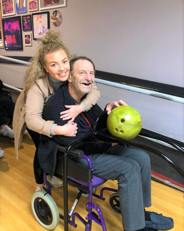 Meyrick Rise Care Home, Bournemouth-Carer Emily and resident Phillip having fun at Hollywood Bowl