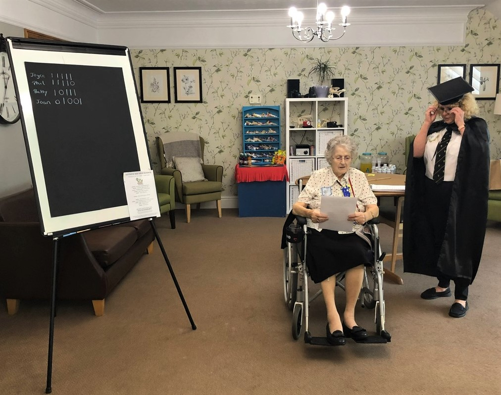 Meyrick Rise Care Home, Dorset-Resident Betty does brilliantly in her spelling test much to the delight of our 'headmistress' aka team member Leanne!
