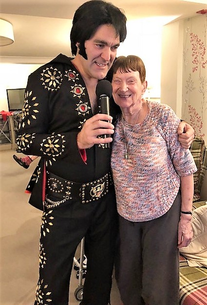 Elvis gives resident Mavis a hug as he sings one of his all time greats