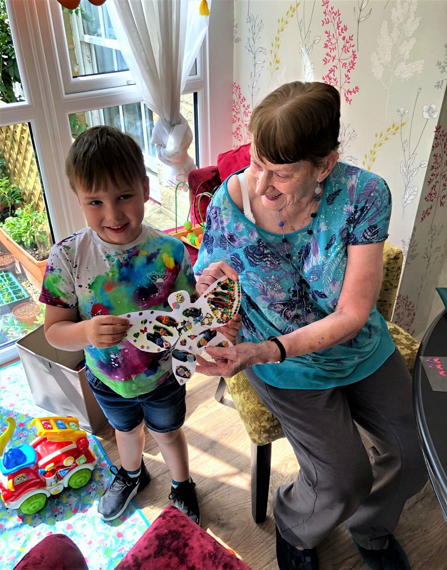 Mill House Care Home, Oxfordshire-Resident Mavis and Greyson proudly show us their finished butterfly
