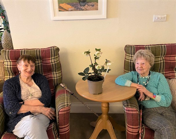 Mill House Care Home, Oxfordshire-Residents Mavis and Sheila with the beautiful hellebore which will flower every year around Valentine's Day