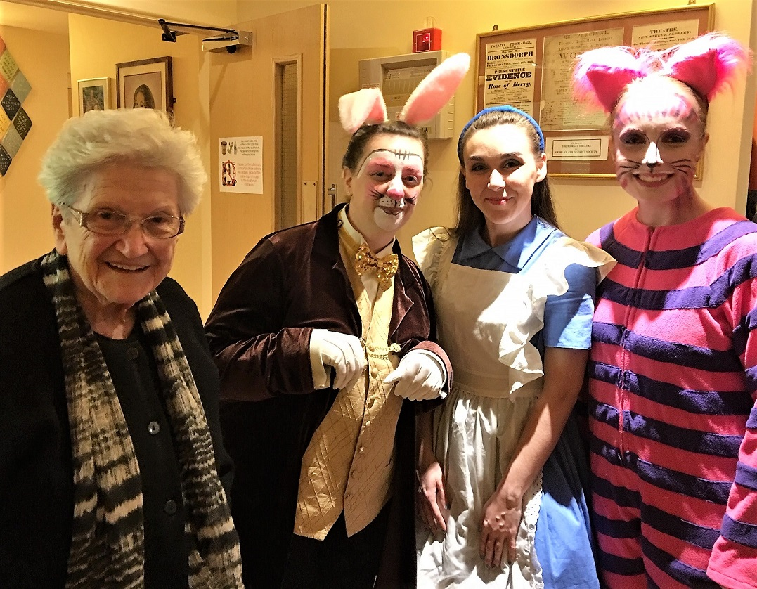Resident Pam with some of the cast members; The White Rabbit, Alice, and The Cheshire Cat