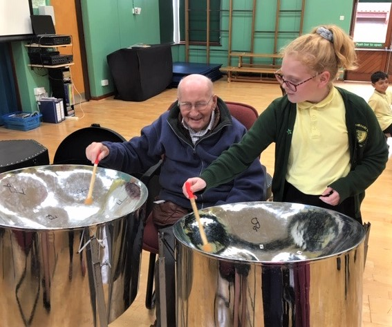 Ross Court Care Home, Herefordshire-Resident Peter and pupil Erica plays the drums together