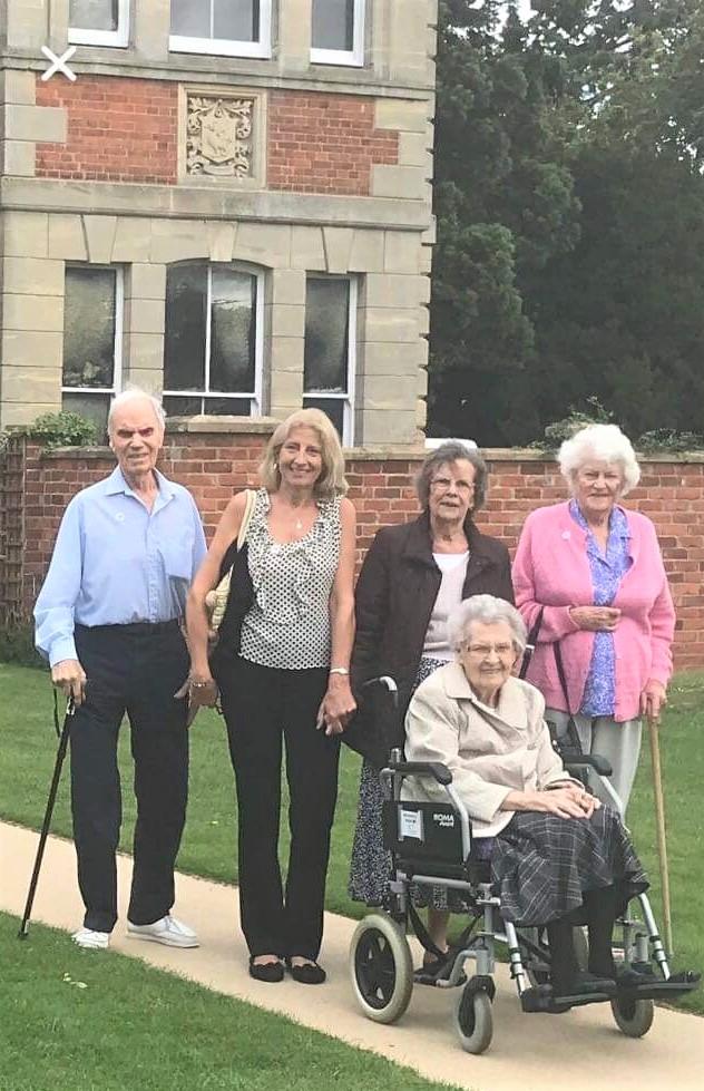 Ross Court Care Home, Herefordshire-Resident Peter, team member Melanie and residents Rosemary, Brenda and Thelma in the beautiful grounds of Wallsworth Hall