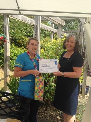 Sahsa receiving her award from home manager Jacqui Burvill