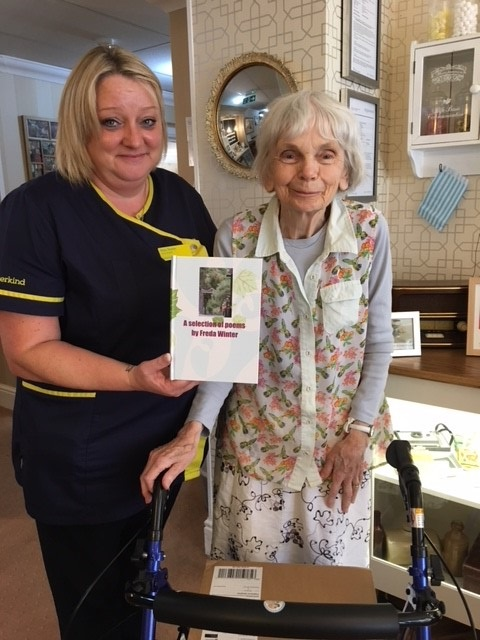 Home manager, Sam Towse with Freda proudly showing off the book of her poems