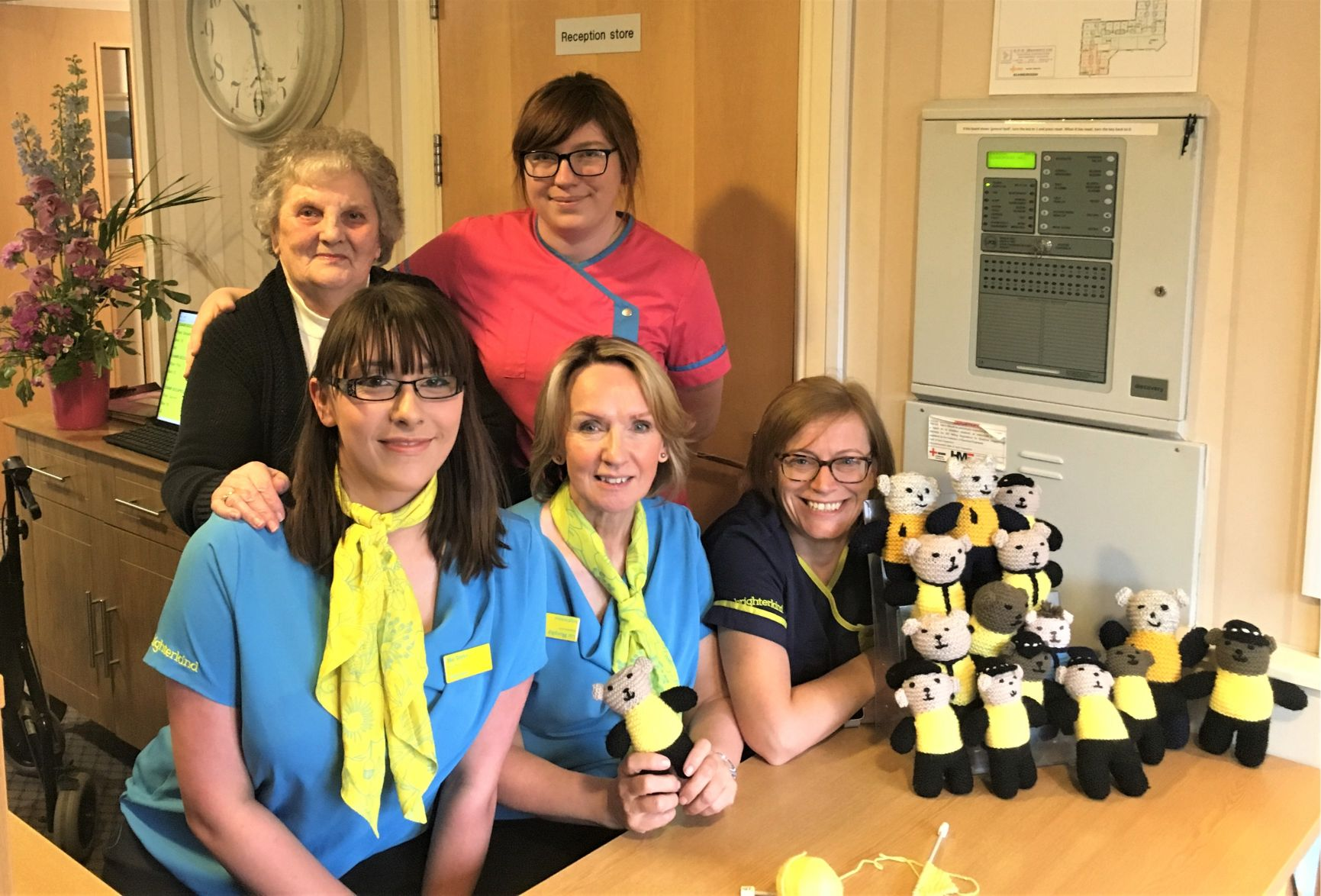 Scarborough Hall Care Home, North Yorkshire-Resident Muriel and team members Skigh, Mel, Liz and Lynsey with just some of the knitted Bobby Buddies