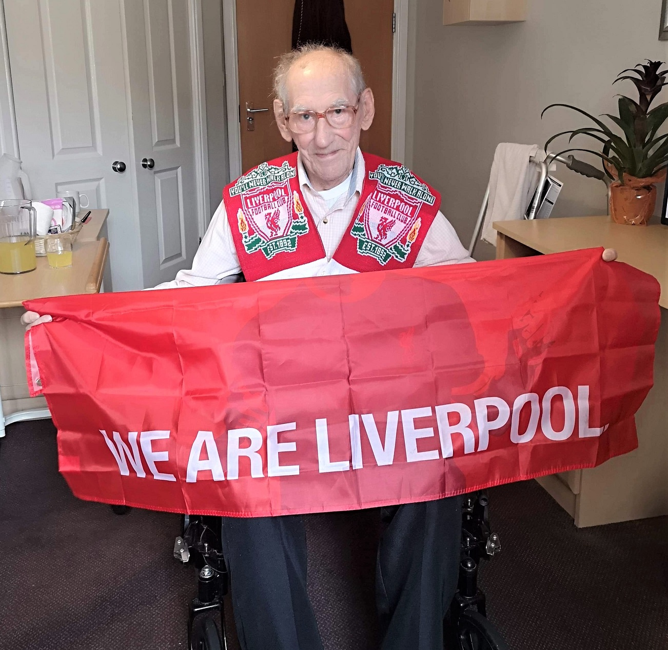 Scarborough Hall Care Home, North Yorkshire-Resident Ray with his goodies from Liverpool Football Club