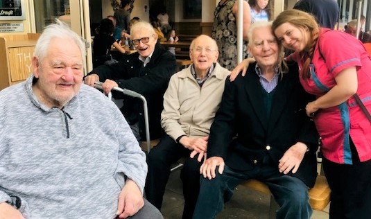 Scarborough Hall Care Home, North Yorkshire-Residents George, Bert, Lawrence and Brian with Magic Moments Club Assistant Jessica