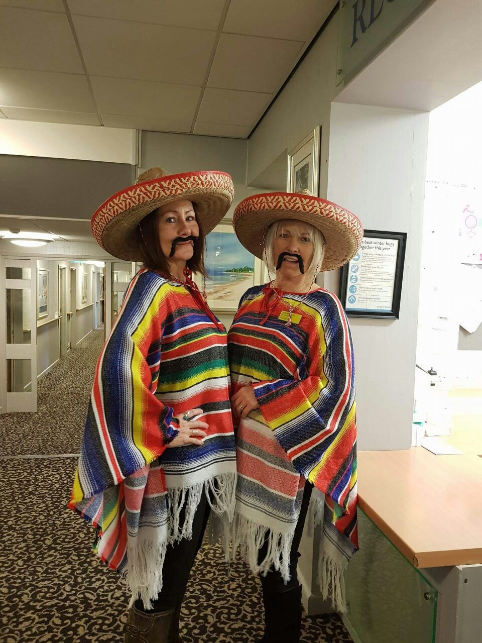 Team members Debs and Vicki in their ponchos and sombreros