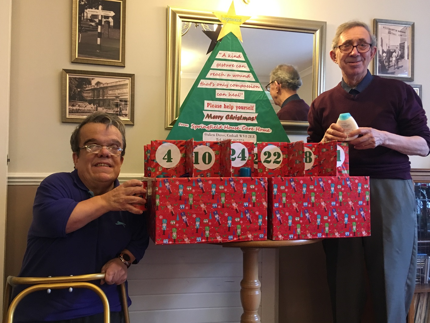 Residents Robert Day and Peter Bristow putting the final touches to our Advent calendar for the homeless