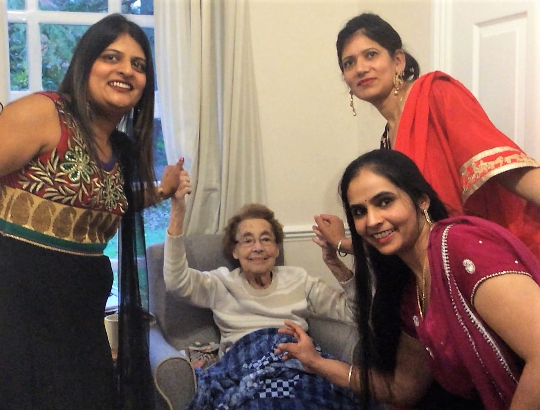 Team members Hema Patel, Baljinder Dheensa and Manjit Kaur teaching resident Esme Adams some dance moves