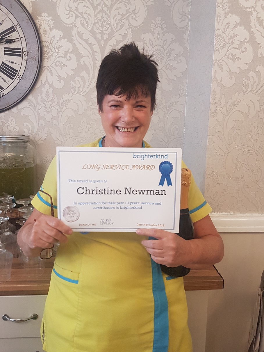Senior Carer Christine Newman receiving her 10 years service award