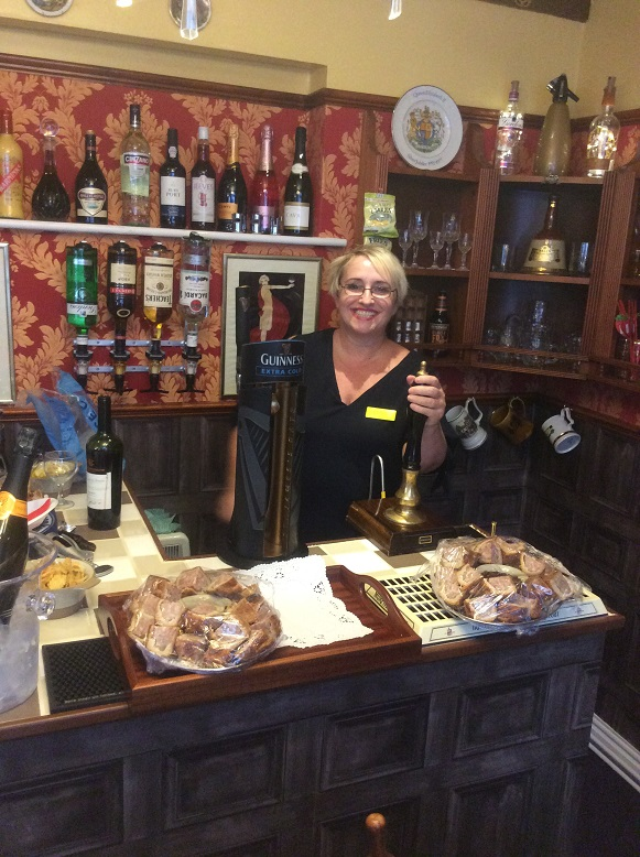 Service with a big smile. Home Manager Ria Percival tending the beer pumps