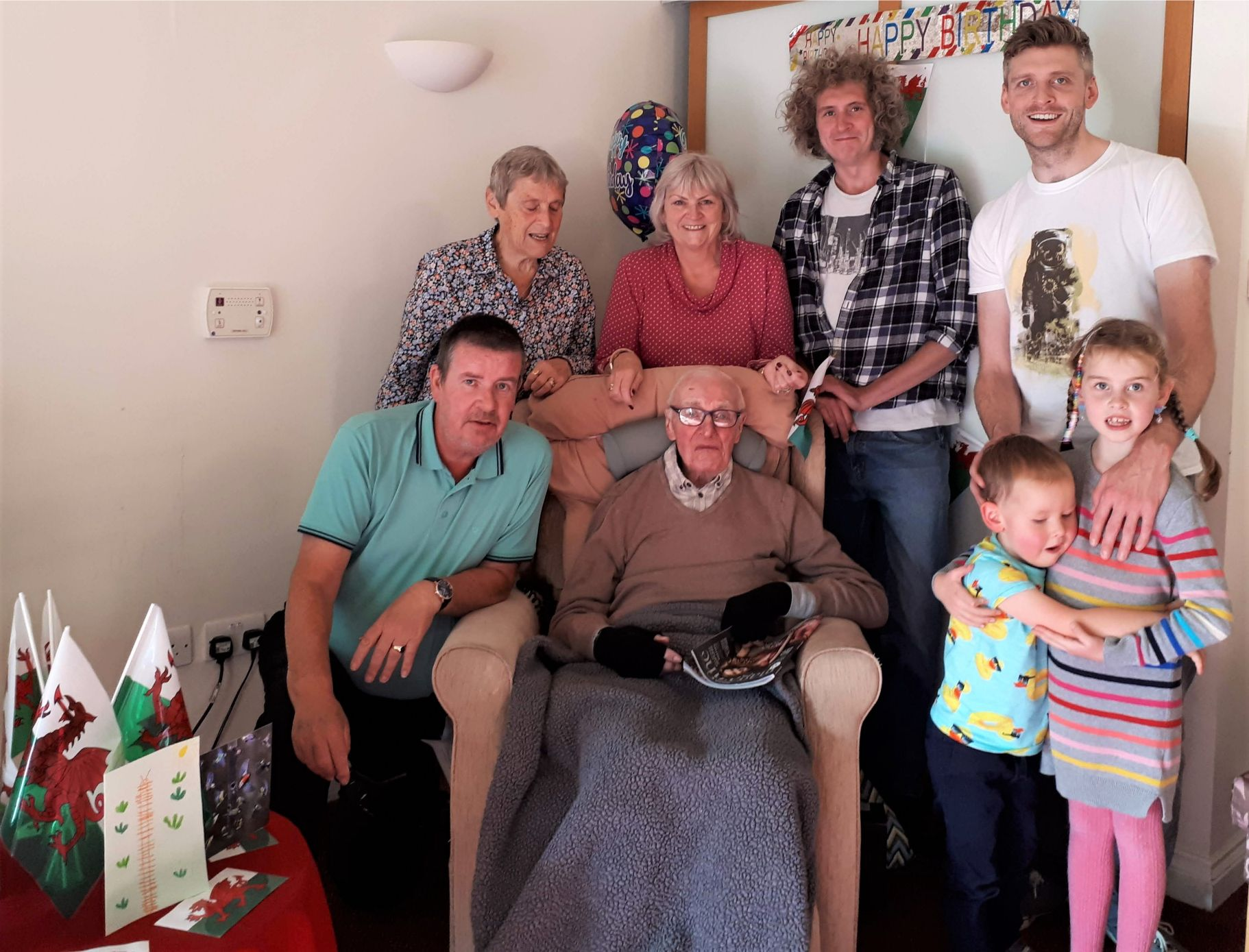 Tewkesbury Fields Care Home, Gloucestershire-Paddy surrounded by his family for his special Welsh themed birthday tea