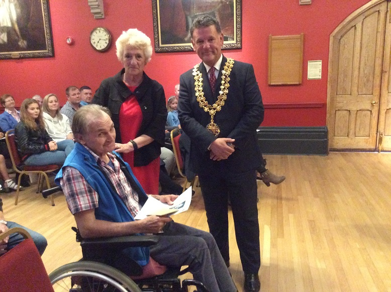 Resident Donald Teague receiving the award from The Mayor of Wokingham Town