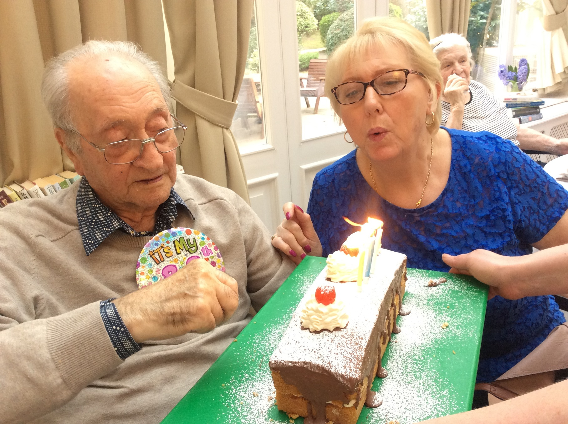 Resident Frantz with his relative Joan, celebrating his 88th Birthday