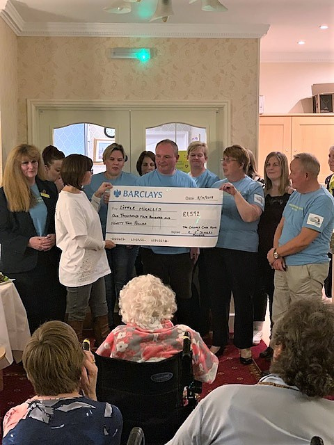 Team Cedars presenting their cheque for £1592 to the Little Miracles charity