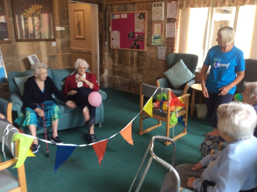 Residents Margaret and Margaret fought a competitive armchair volleyball battle!