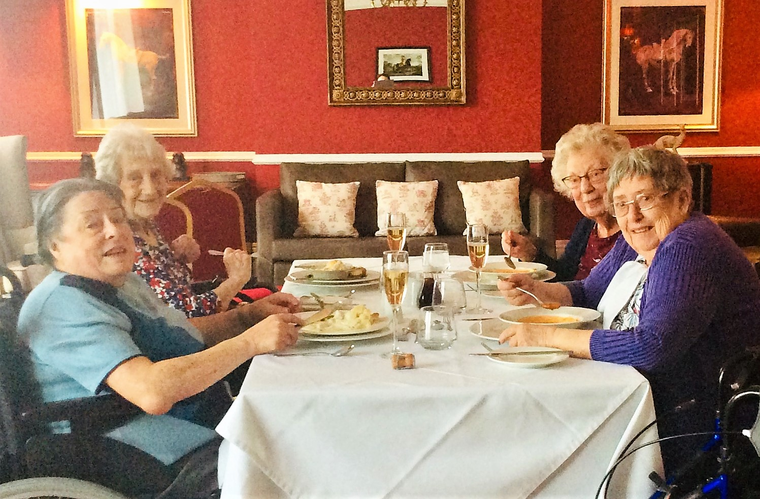 Residents Maureen, Joan, Betty and Val enjoying their surprise champagne lunch