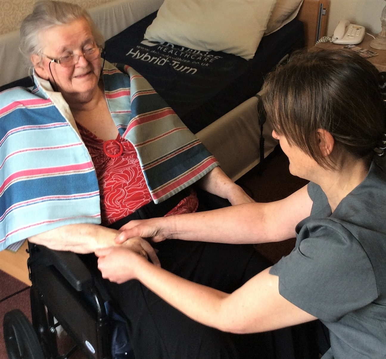 The Granby Care Home, Harrogate-Resident Wendy enjoys a relaxing hand massage from Aromatherapist Karen Taylor