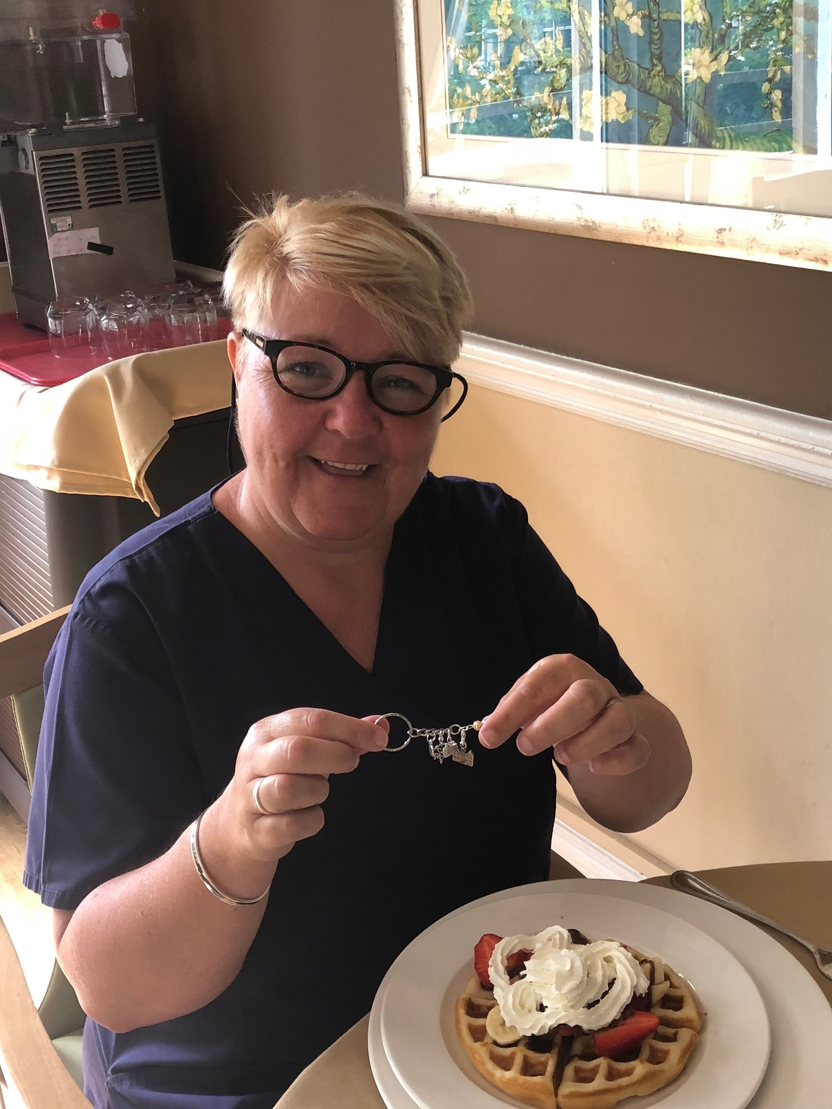 Nurse Debbie Heaton with her waffles and charm gift
