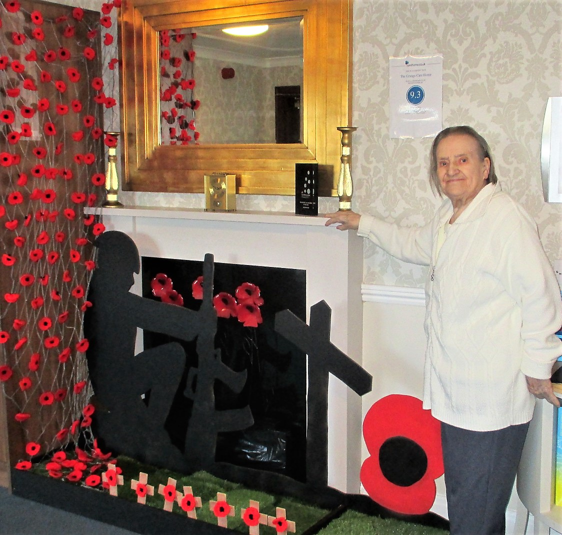 Resident Agnes Southam standing proudly by our display for Remembrance Day