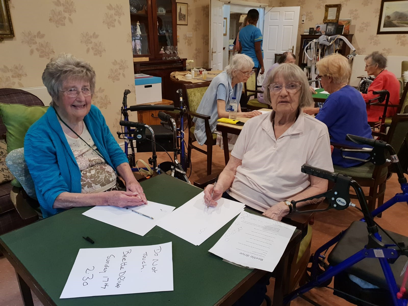 Residents Irene Hutchinson and Freda Winter prepare to play 'Beetle Drive'