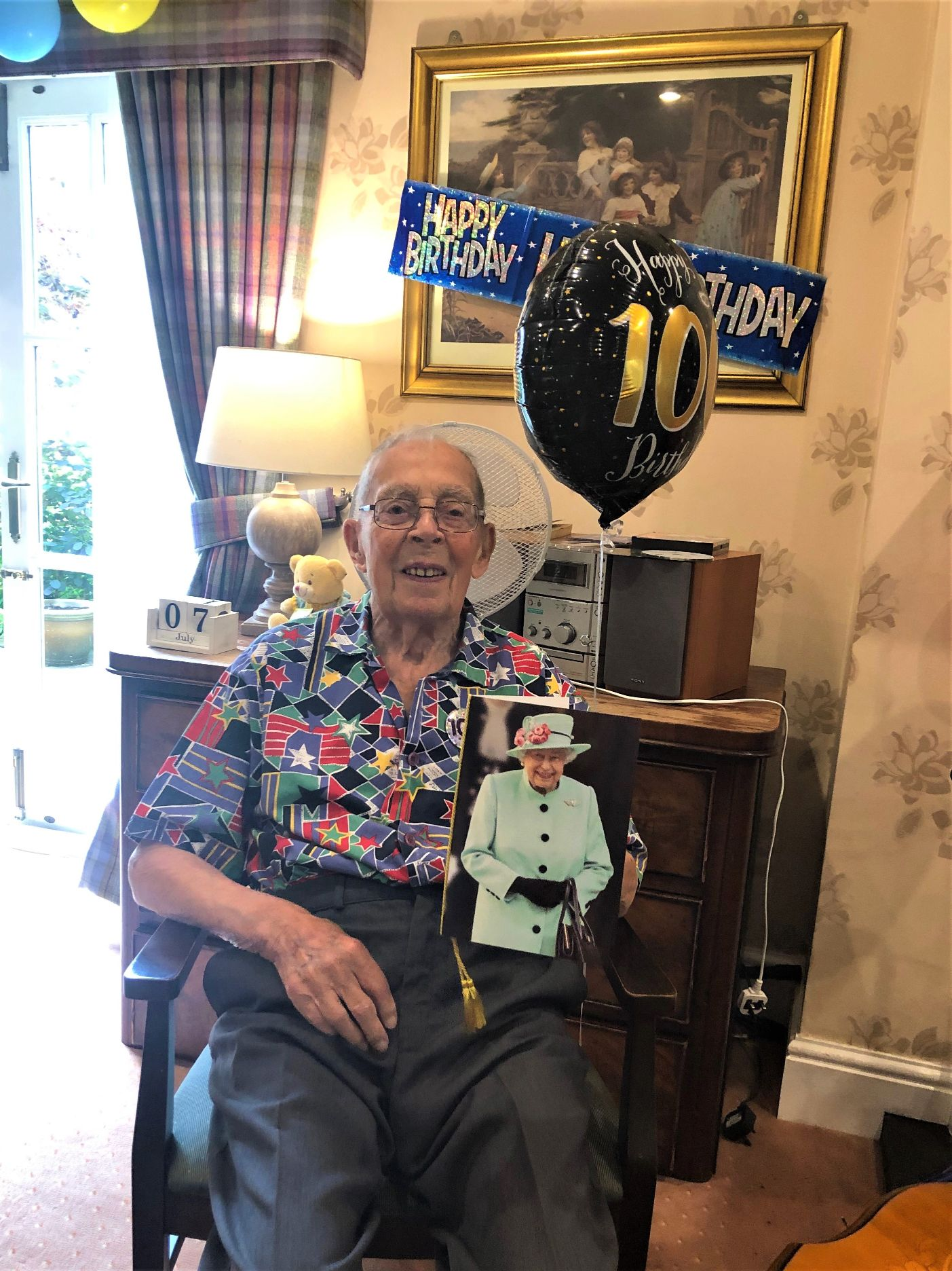 The Lawns Care Home, Oadby-Doug holding his 100th Birthday card from The Queen