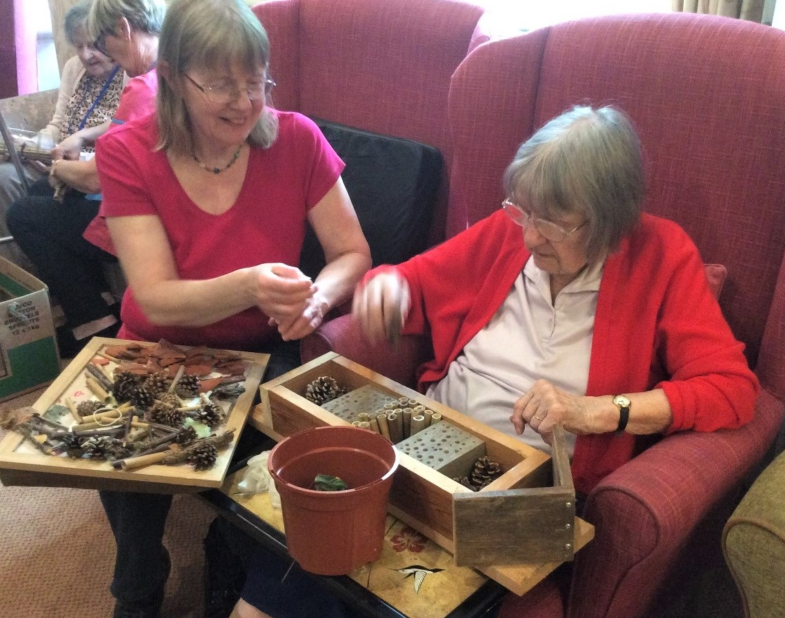 The Lawns Care Home, Oadby-Resident Margaret and her daughter Elizabeth making a bug hotel for the garden