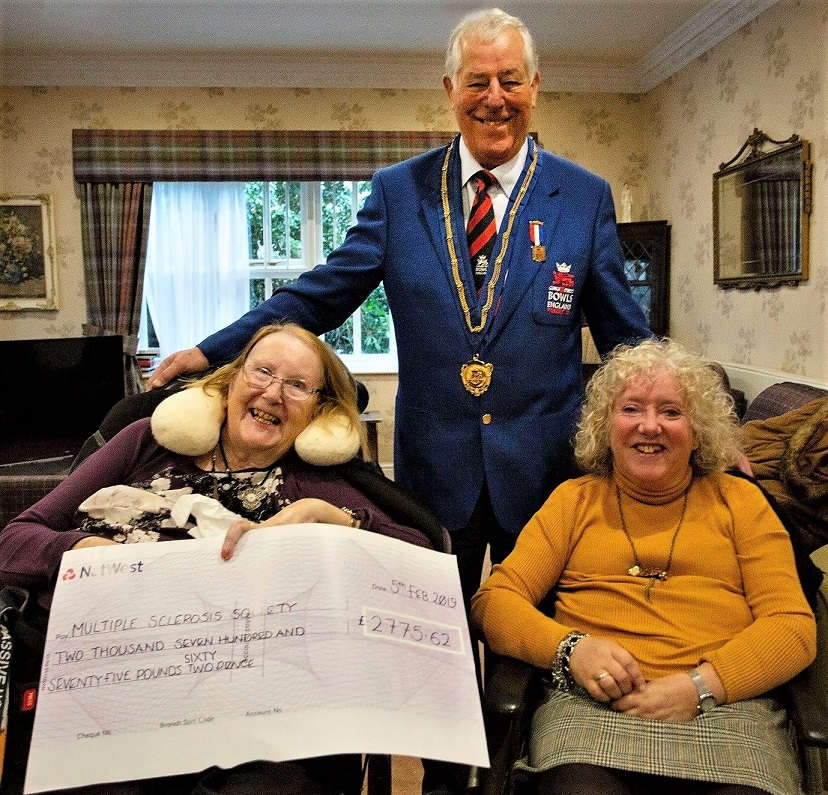 Resident Su, her friend Bill and Jane from MS Society at the cheque presentation