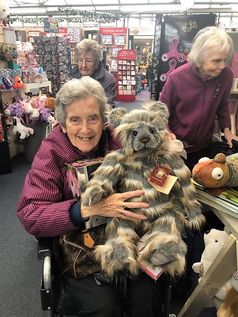 Resident Pat Perkins enjoying a cuddle with her new friend at the garden centre!