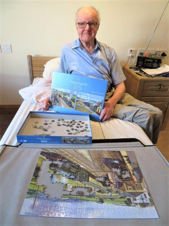 Westbury Court Care Home, Wiltshire-Resident David with his nearly complete jigsaw puzzle