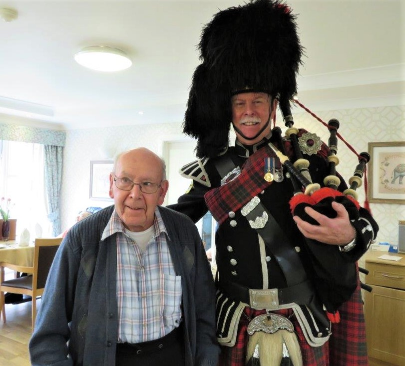 Westbury Court Care Home, Wiltshire-Resident Derek with Bagpiper Bob at our Burns Night celebrations