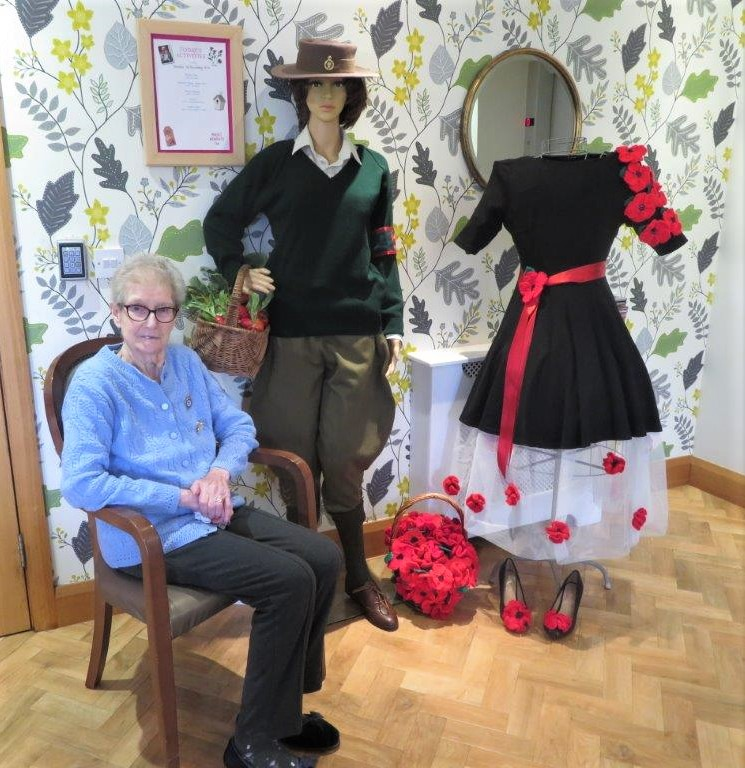 Westbury Court Care Home, Wiltshire-Resident Lois with our Land Girl uniform and poppy dress