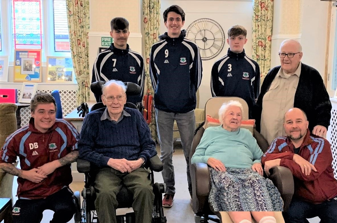 Woodbury House Care Home, Berkshire-Residents Ken, Edith, and Ivan with the Spencers Wood football team. Back row Scott Mann, Charlie Pilkington, Carlos Bustamante, and front Dan Bunting and Paul Bunting