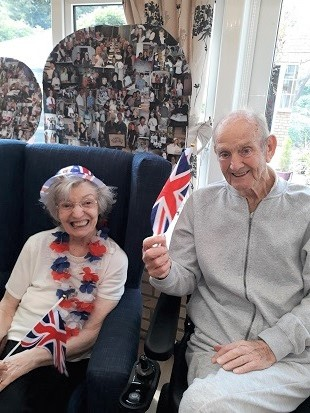 Pam and Max proudly waving the flag at our Last Night of the Proms event
