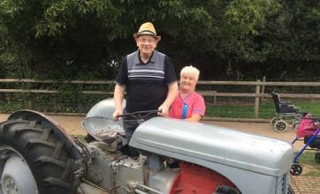 Brian and Debs (Magic Moments Club Assistant) admiring the tractor