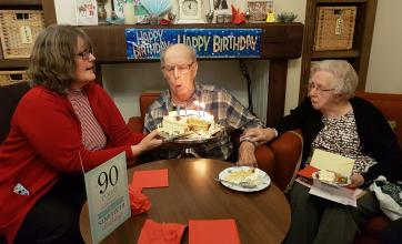 Peter blowing out the candles on his birthday cake