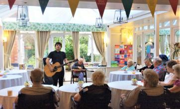 Resident Ron and musician Mitch perform on their guitars!