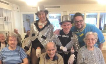 Albany Care Home, Oxfordshire-Residents Jean, Joyce and Eric and team member Carlo with the 'Tickled Pink' performers