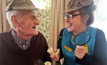 Angusfield-Our super sleuths resident John and Magic Moments Club Coordinator Stacey having fun at our murder mystery event.jpg