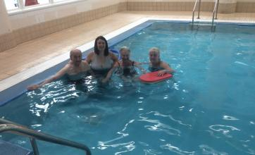 Residents Olive and Brian with team members Laura and Debs enjoying their swim