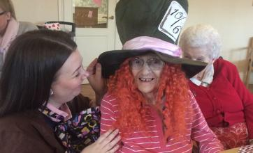 Resident Joy Dilistone trying on the Mad Hatter's hat