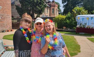 Boroughbridge Manor Care Home, North Yorkshire-Team member Shelbie, volunteer Sue and team member Suzanne are festival ready!