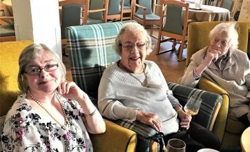 Residents Cathy, birthday girl Netta and Jean enjoying celebratory drinks and chocs on Netta's birthday