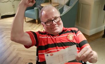 A delighted Kevin with his winnings