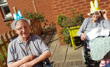 Charlotte House Care Home, The Wirral-Residents Ron and Freda taking part in our Easter bonnet parade