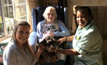 Claremont Parkway Care Home, Kettering. Resident Anne receives a visit from Kettering Hospital physiotherapists Rebecca and Greta and had a lovely surprise when Rebecca brought Monty her dog to say hello
